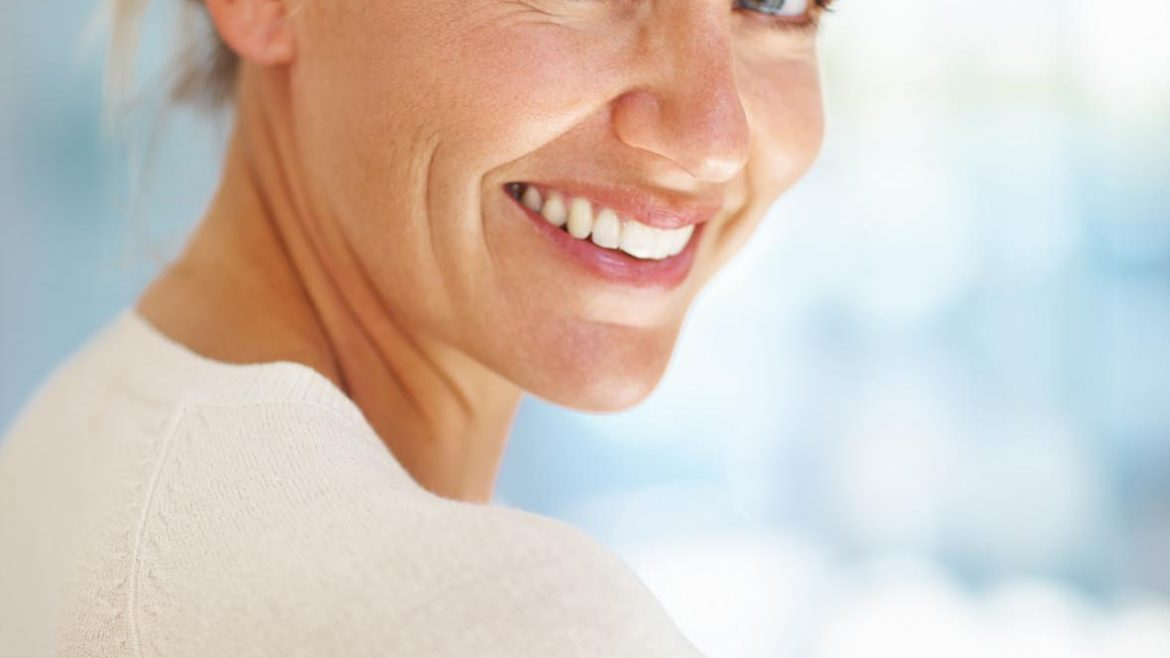 Beautiful older woman smiles at the camera - Live your life to the full with dental implants from Oakwood Dental Practice - serving the people of Botley, Hedge End, Bishops Waltham, Winchester and the wider Hampshire community