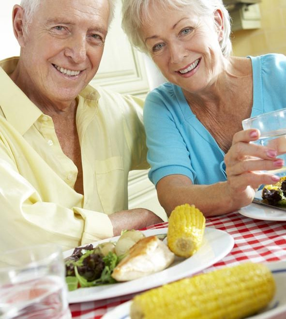 Couple with strong healthy teeth enjoy eating