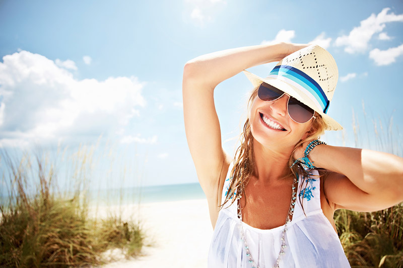 Woman smiling on beach in summer